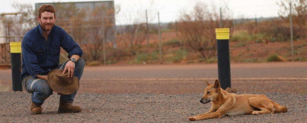 Dr. Thomas Newsome with dingo