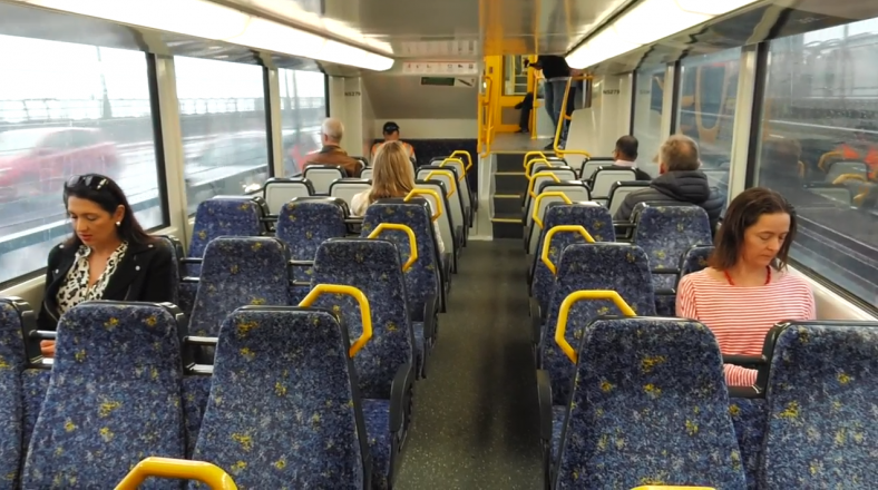 Sydney-commuters-on-a-train-using-social-distancing measures